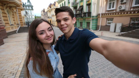 Cheerful young couple taking selfie on mobile phone Footage