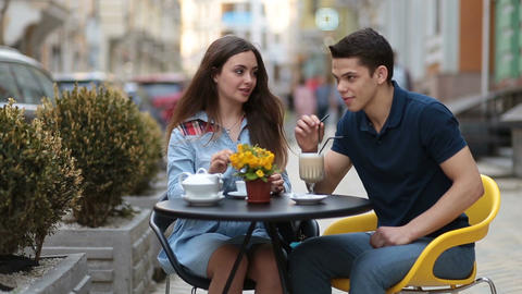 Attractive couple relaxing in sidewalk cafe Footage