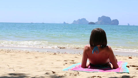 Young Brunette Girl Sitting on the Beach Footage