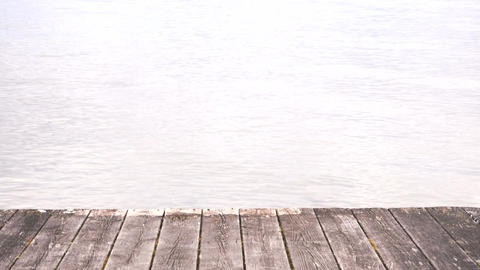 Empty wooden jetty and water. Tranquil scene by sea with copy space Footage