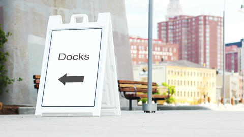 Docks foldout sign in downtown metropolitan area during daylight Live Action