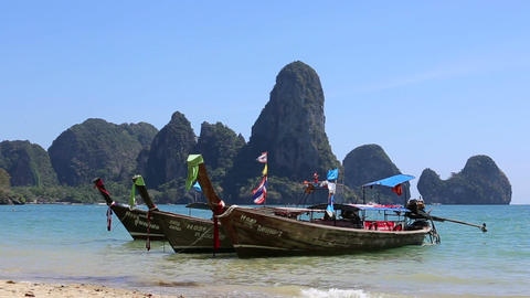 Longtail Boats Stands in Water against Islands Footage
