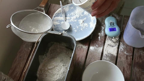 Woman Hands Put Yeast into Flour Footage