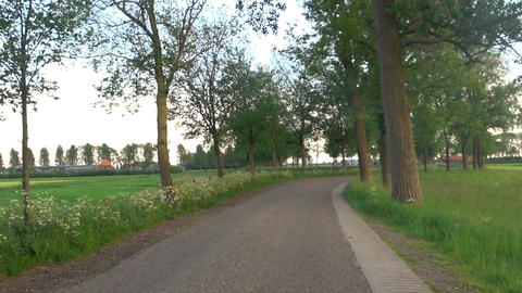 Cycling on a winding country road during a beautiful evening in spring