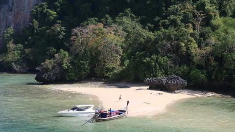 Motor Speed Boat Tied up at Rocky Island Coast Footage