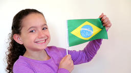 Cute girl holding flag of Brazil Footage