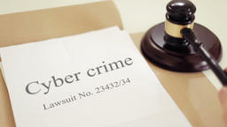 Cyber crime lawsuit verdict folder with gavel placed on desk of judge in court Footage