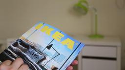 Editorial holding IKEA catalogue Footage