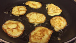 Flipping latkes pancakes fried in oil and butter Footage