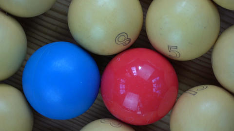 Rotating colorful vintage billiards balls on table with numbers Footage