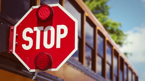 Retro school bus color graded shot of stop light flashing Stock Video Footage