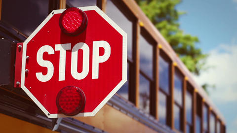 Retro school bus color graded shot of stop light flashing Footage