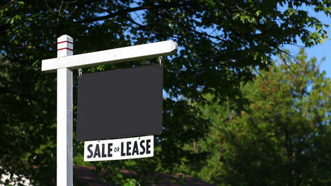 Generic Blank Real Estate sign in yard with green trees in background Footage