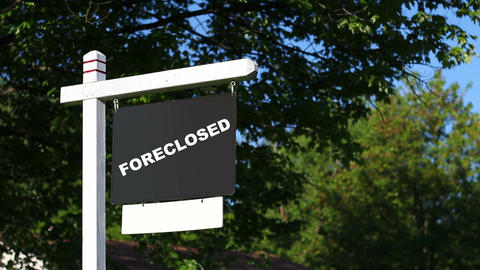 Foreclosed Real Estate Sign in front yard infront of property Footage