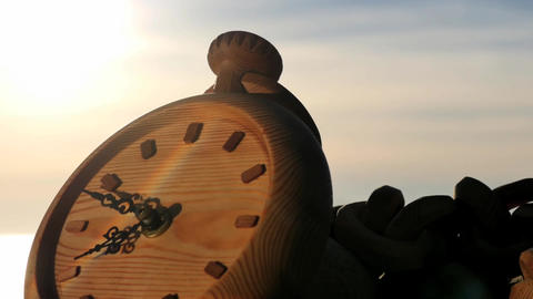 Clock left at sunset near sea shore zooming time lapse Footage