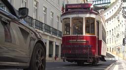 Lisbon tram pass in the street Footage