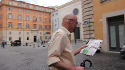 Lost tourist holding a tourist map Footage