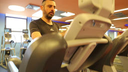 Man on a treadmill inside the gym Footage