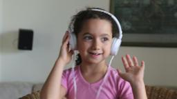 Sweet little girl with headphones Footage