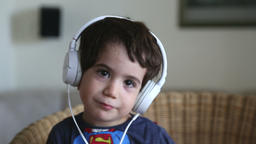 Adorable boy with headphones Footage
