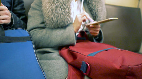 Woman using her cell phone in metro, message, sms, e-mail Archivo