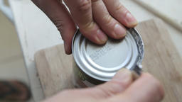 Opening tin can with can opener Footage