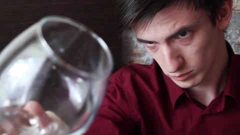 The young barman polishes the cognac glass Footage