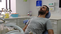 Relaxed patient sitting on dentist chair Footage