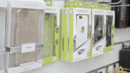 Smartphones covers on display in a store Footage