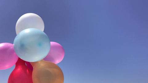 Multicolored balloons against the sky Footage