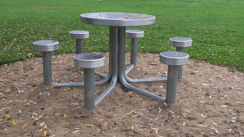 Metal seats round the table at playground Footage