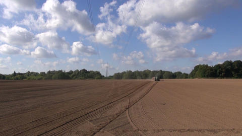 Agriculture tractor sowing seeds on field on sunny day Footage