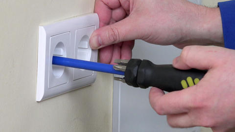 Electrician hands install electrical wall sockets Footage