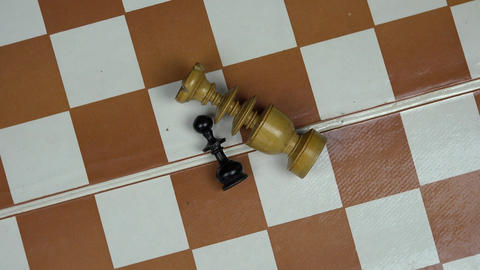 wooden chess figures lying on chess board. turntable Footage
