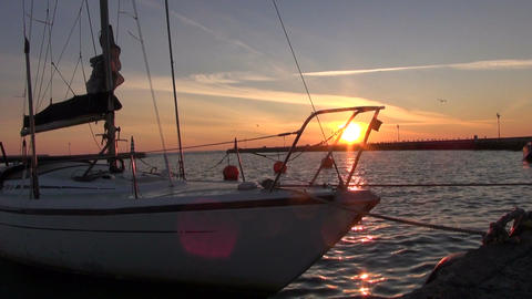 Morning sunrise in sea harbor with ship and orange buoy Footage