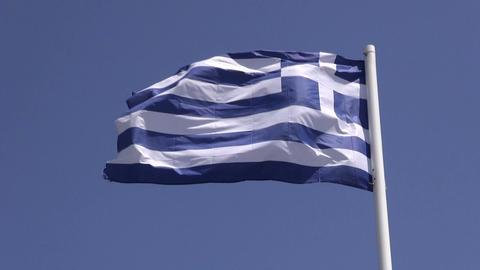 Greek flag waving on windy sunny day Footage
