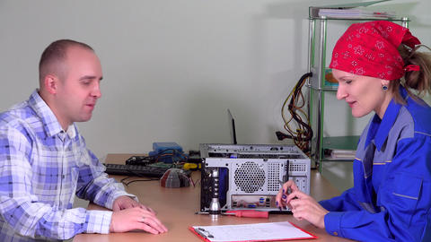 Professional computer specialist woman give repaired tablet computer to man Live Action