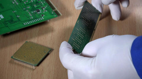 computer specialist examine RAM memory module on wooden background Footage