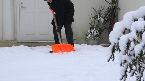 man clean snow with shovel from home path cold winter time. 4K Live Action