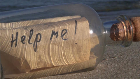 Seascape with bottle with message Help me in the sand Footage