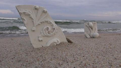 Ornamental floral broken plaster casts by sea Filmmaterial