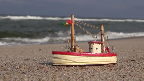 Wooden nautical toy on the beach ビデオ