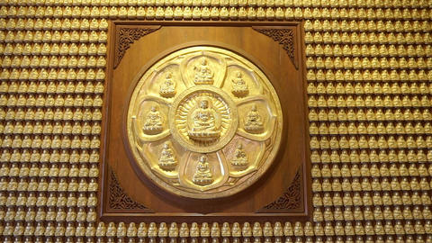Golden buddha at wall in temple (Panning shot) Footage