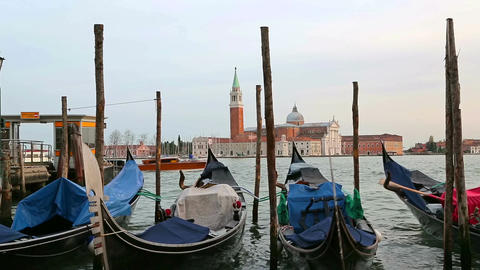Parked gondolas sway on the waves in Venice Live Action