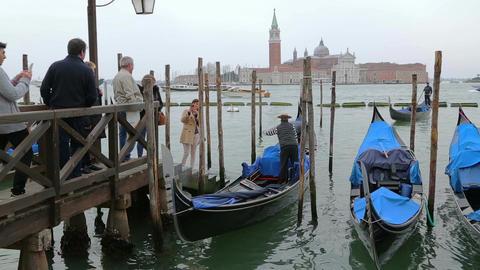 Tourists on the pier near the gondolas Live Action