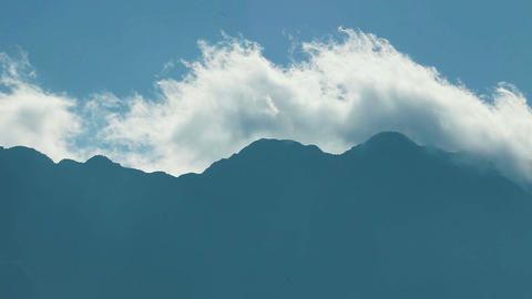Clouds over the Fancipan mountain Footage