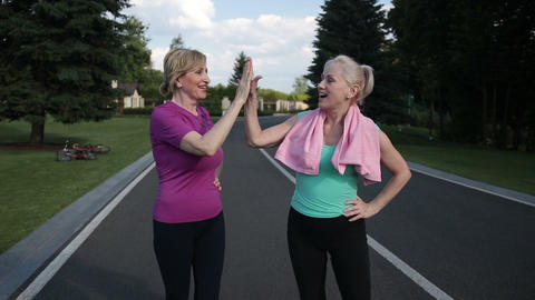 Running females giving high five after training Footage