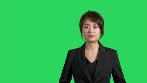 Asian Chinese businesswoman or presenter presenting on greenscreen
