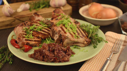 Delish pork chops with caramelized onion and herbs footage Footage
