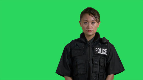 Asian Chinese policewoman smiling on green screen Live影片